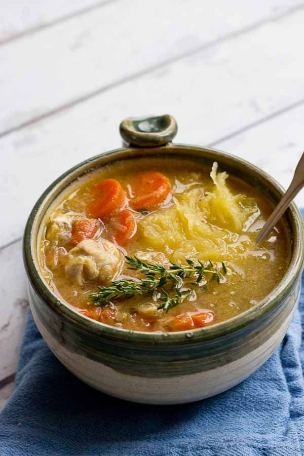 """Chicken """"No Noodle"""" Soup is filling but won't weigh you down. It's deliciously flavorful and chockfull of chicken and made with spaghetti squash instead of egg noodles. This low carb Chicken No Noodle Soup makes a yummy lunch and works great for meal prep."""