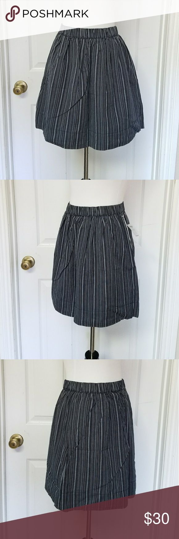"""NWT Striped GAP Skirt NWT Blue and white striped skirt by GAP with elastic waistband and side pockets. Fully lined. Shell is 86% cotton 14% linen and lining is 100% cotton. Laying flat waist measures 13 1/2"""" unstretched and length measures 17"""". GAP Skirts Circle & Skater"""
