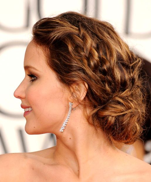 "Girl on Fire - These braids may not be quite as elaborate as the ones Katniss dons in ""The Hunger Games,"" but Jennifer Lawrence's classic braid-and-low-bun combo is perfect for combating spring showers."