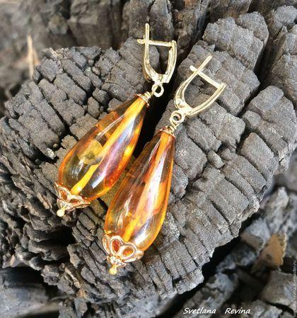 Осенние Капли   серьги  из  янтаря в интернет-магазине на Ярмарке Мастеров. Серьги из настоящего калининградского янтаря и бронзы. Серьги в виде капелек, очень легкие, солнечные и подвижные. Очень жалко было закручивать эти прекрасные камушки в проволоку, поэтому оформила очень просто, но в качественную фурнитуру из настоящей бронзы, а швензы - бронза в позолоте. Для настоящих ценителей! Извининяюсь за качество фото! ВНИМАНИЕ!