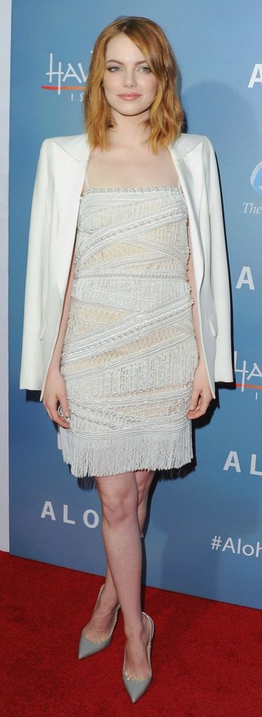 Emma Stone at the Aloha premiere wearing a flapper-inspired dress. We loved how she paired this fun and flirty piece with a polished white blazer and neutral pumps.