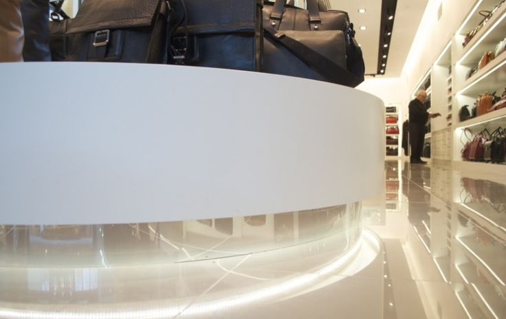 Discrete lighting bouncing off white glossy surfaces makes this retail location a great place to shop.