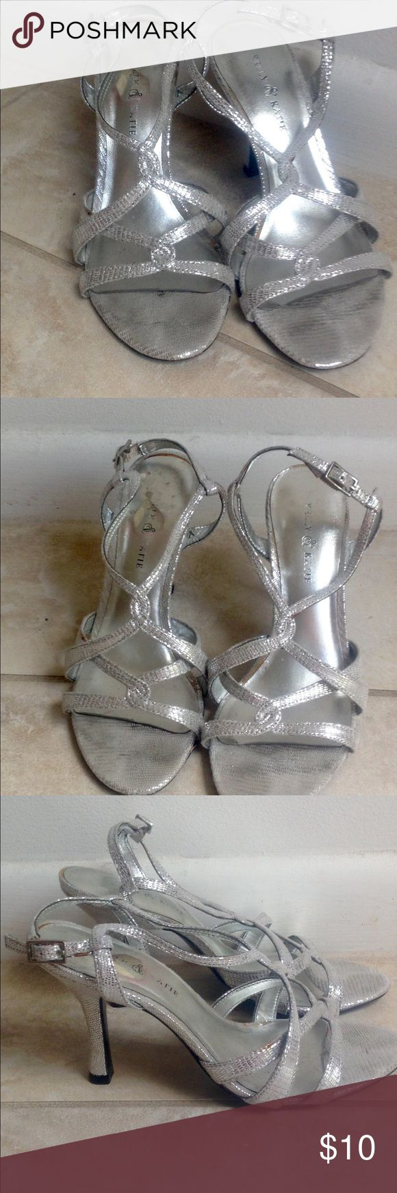 Kelly and Katie silver dress pumps Gently worn Kelly & Katie silver dress sandals. Shoe has an alligator like pattern. Heel height is 3.75 inches. Kelly & Katie Shoes Sandals