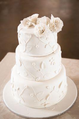Simple, elegant white wedding cake. #wedding #cake #weddingcake #simple #white #fondant #chocolate #weddingphotography #photographer #jessicanotelo