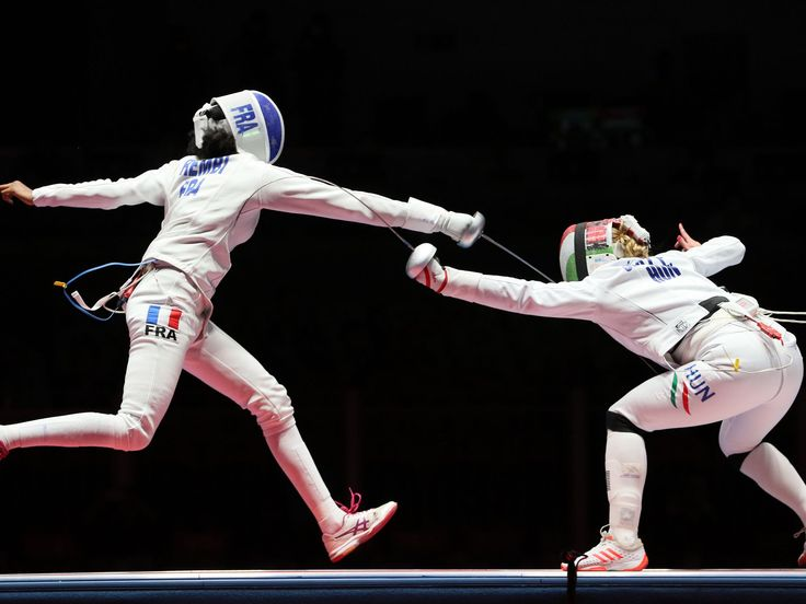 Emese Szasz (HUN) and Lauren Rembi (FRA) compete during the women's epee individual semifinals in the Rio 2016 Summer Olympic Games at Carioca Arena 3.  David E. Klutho-USA TODAY Sports