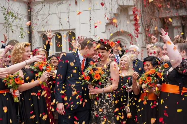 Halloween wedding confetti | Wedding at Stephens House & Gardens in Finchley North London | Black wedding dress | Red yellow and orange confetti | Winter wedding (scheduled via http://www.tailwindapp.com?utm_source=pinterest&utm_medium=twpin)