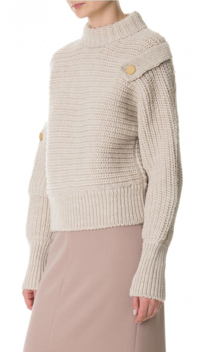 This crewneck pullover is spun from luxuriously soft merino wool with epaulet…