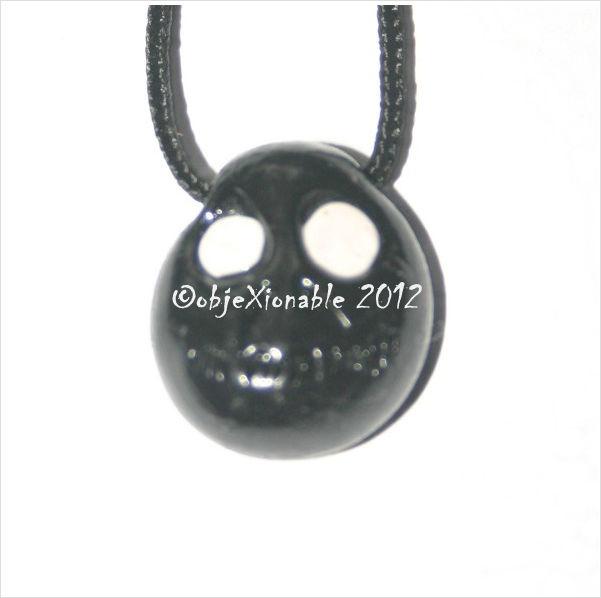Black Shrunken Skull Pendant