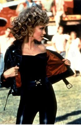 """Olivia Newton John as Sandy - """"Grease"""" (1978)  Fun costuming fact: """"Due to a zipper breaking, Olivia Newton-John had to be sewn into the trousers she wears in the last sequence""""- Taken from IMDb"""