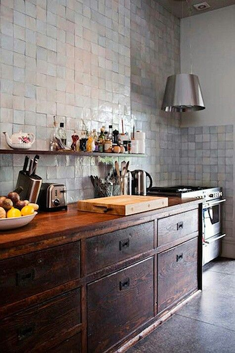 Antique kitchen cupboards with modern stove