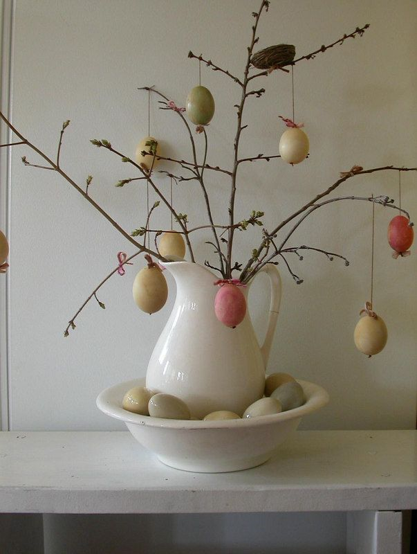 This Easter tree is kind of sad looking, but I like the use of the pitcher/bowl. Spray-paint long sticks/branches white, khaki, or pastel colors - or use pussy willow branches or birch tree branches