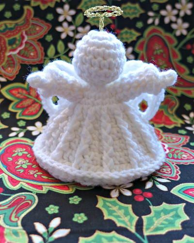 """Make your own crochet angel. My Crochet Angel is crocheted in Red Heart Super Saver (medium weight) yarn; beginning at the top her head and worked in continuous rounds to the base of her skirt."""