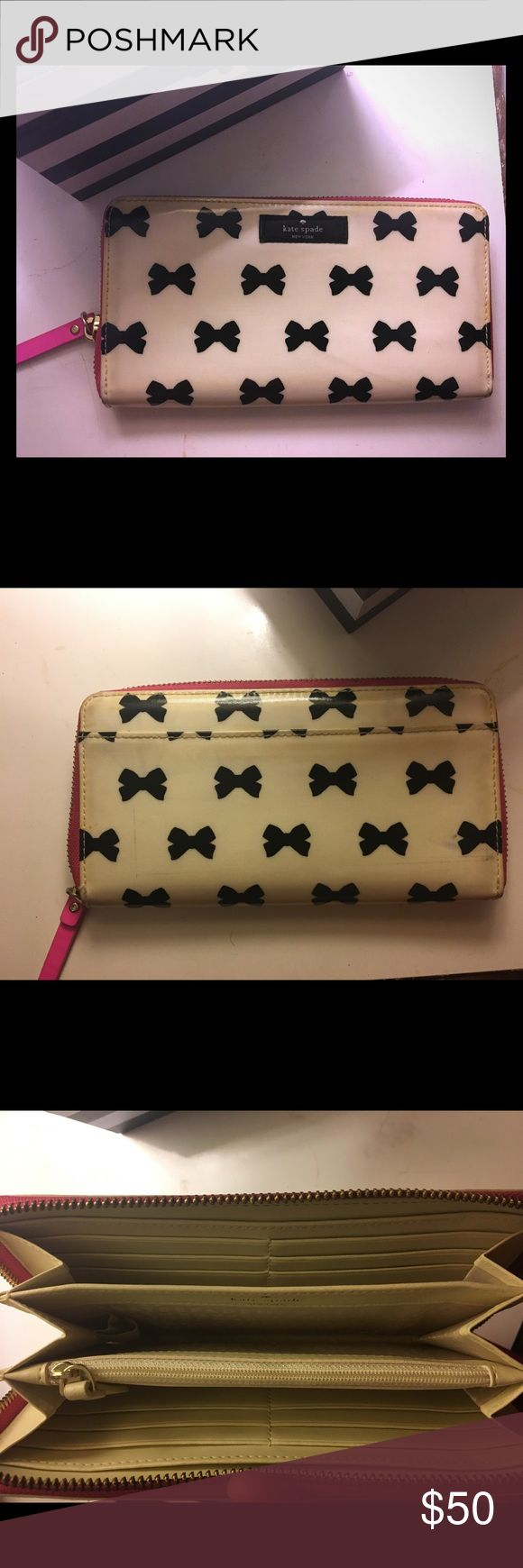 Kate Spade Bow Print Wallet Mid-size wallet with hot pink trim and bow detail. 12 card slots, 3 interior pockets, one exterior pocket. A little worn. kate spade Bags Wallets
