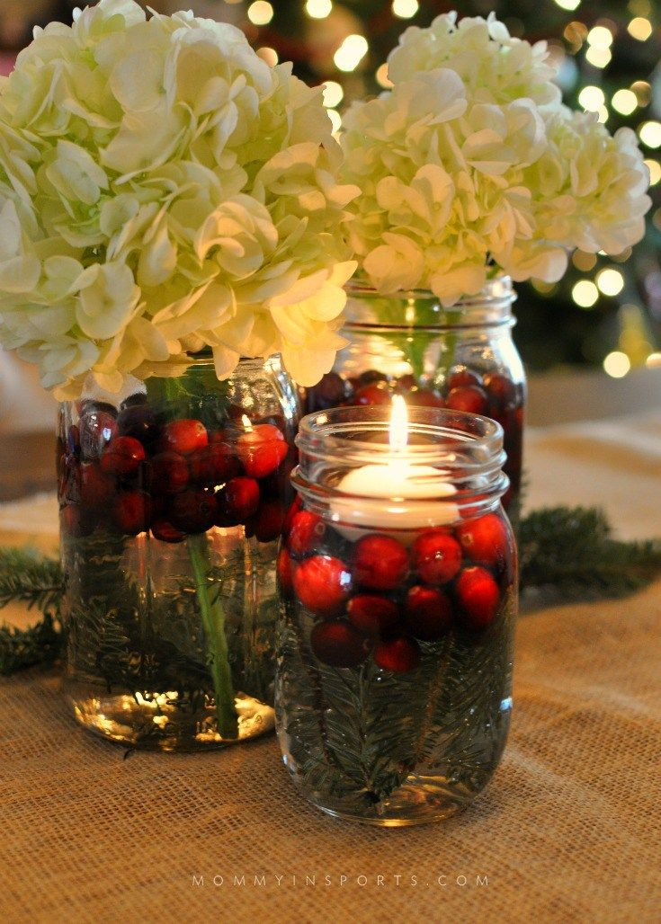 Mason Jars are perfect to use for a holiday centerpiece! Fill them with flowers, cranberries, evergreen clippings, or even pine cones!