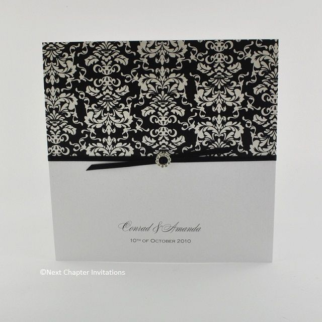 ALLEGRO  An elegant design printed on Ice gold white frosted card and decorated with Adorna Mini Black Invitation Paper from Samara Papers. It is beautifully finished with 3mm black satin ribbon and mini round diamante buckle. Price: $6.25 https://www.facebook.com/NextChapterWeddingInvitations