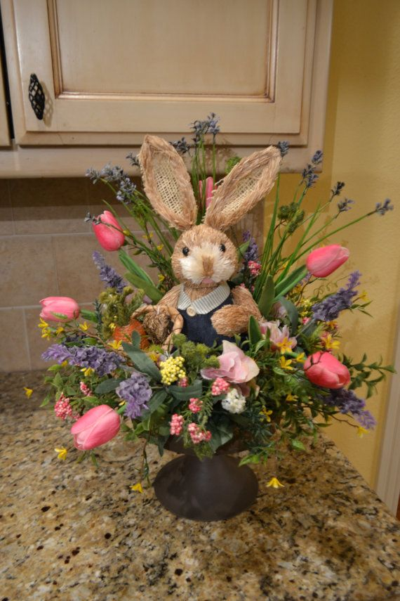 Dress up your table with this adorable spring bunny arrangement! It is full of beautiful silk flowers, greenery, and berries and is made in a