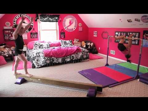 this website has a bunch of cool gymnastics equipment for the home! WAY TOO COOL! Btw... Awesome Bedroom!