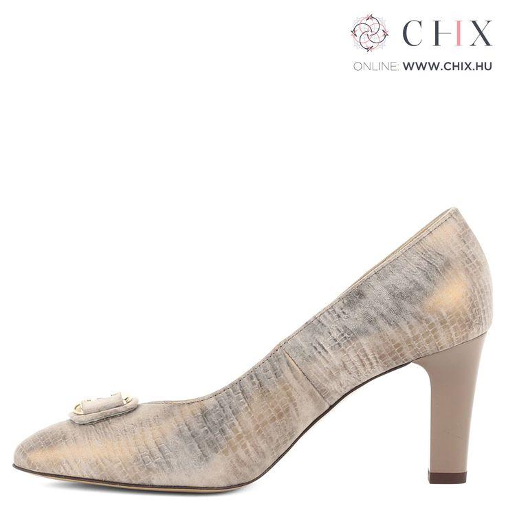 Anis arany színű bőr cipő Anis arany színű magas sarkú cipő, elején arany dísszel. Felsőrésze és bélése egyaránt bőr, sarka 7,5 cm magas. Márka: Anis Szín: Arany Modellszám: 4483 MALTA 3 GOLD http://chix.hu/noi-cipok/13956-anis-arany-szinu-bor-cipo-4483-malta-3-gold/