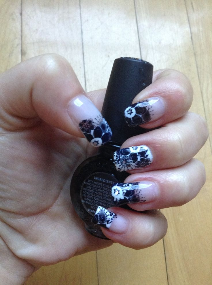Black and white. Gelish with pueen stamping.