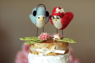 This cake topper has accessories that guests will connect with.  I definitely do; I'm the red bird with glasses.  :)