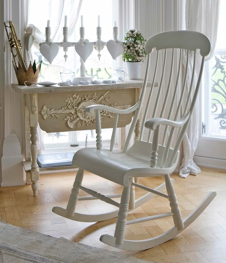 I was just given a free wooden rocking chair like this, thinking about painting it white and putting it in Audrey's nursery. So old fashioned.
