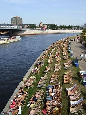 Berlin..we took a boat ride through Berlin and saw this. Lined with people sunbathing. Fun!