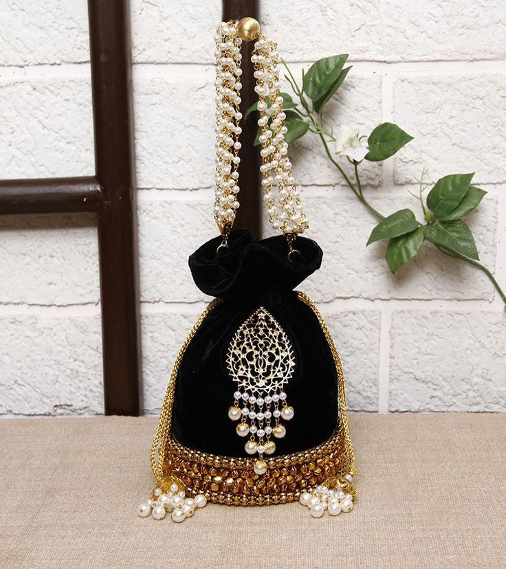 FALAH - Black Embellished Velvet Potli Click on the photo to shop it! :)