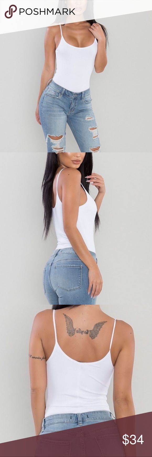 Shae Ribbed Cami Bodysuit [White] I love simple pieces like this ribbed bodysuit that I can layer underneath clothing. Wear it alone with denim bottoms for summer or layer underneath a cardigan for fall! Perfect for all year round! Material is so soft & stretchy.  Available in other colors.   * Bottom button snap closure  * 95% rayon, 5% Spandex * Hand wash cold Other
