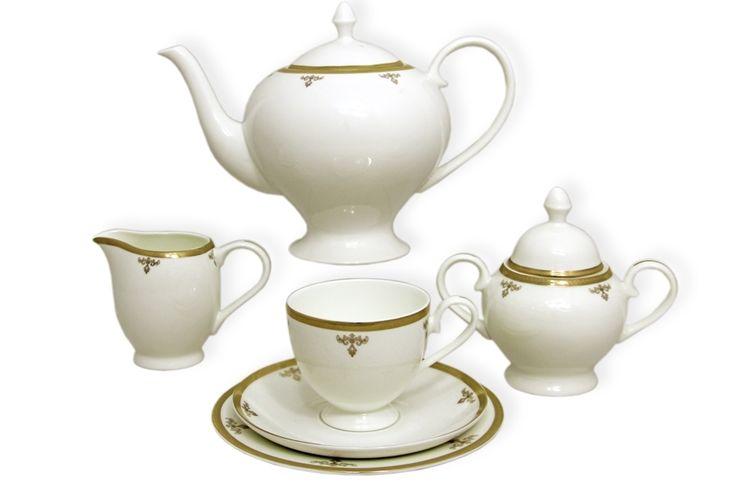 Чайный сервиз из костяного фарфора на 6 персон «Ампир»      Бренд: Emerald;   Страна производства: Китай;   Материал: костяной фарфор;   Количество персон: 6;   Количество предметов: 21 шт;   Объем чашки: 200 мл;   Объем чайника: 1,5 л;   Объем молочника: 300 мл;   Объем сахарницы: 350 мл;         Чайный сервиз из костяного фарфора на 6 персон «Ампир» состоит из:         6 чашек по 0,2 л;      6 блюдец;      6 десертных тарелок 18 см;      1 заварочный чайник 1,5 л;      1…