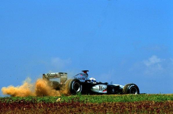 David Coulthard (GBR) McLaren Mercedes MP14/17 has an off track excursion  Brazilian Grand Prix, Interlagos, 31 March 2002