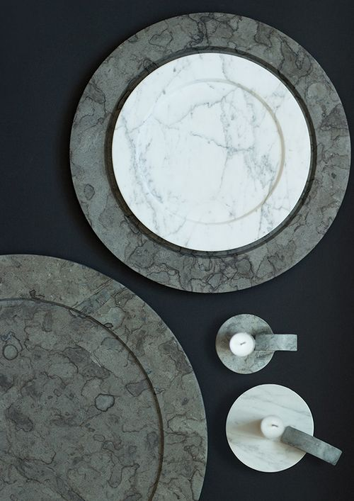 Platters and candlesticks in limestone and marble