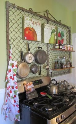 A fence gate as a pot rack and spice holder. This sure stirred up my thoughts.......I have some chicken wire panels from an old rabbit hutch, 2 empty walls alongside my pantry.........