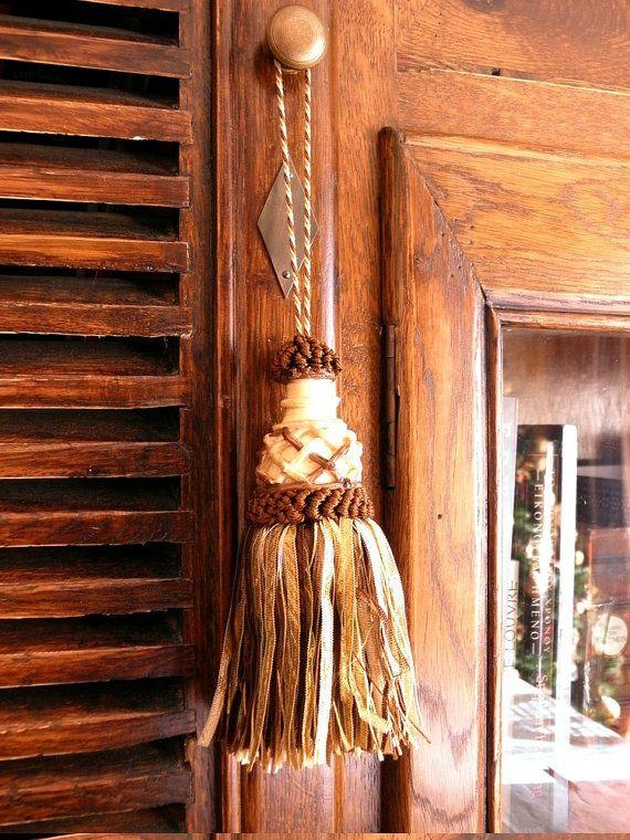 Brown beige tassel gold key tassel supply for roman by Eleptolis
