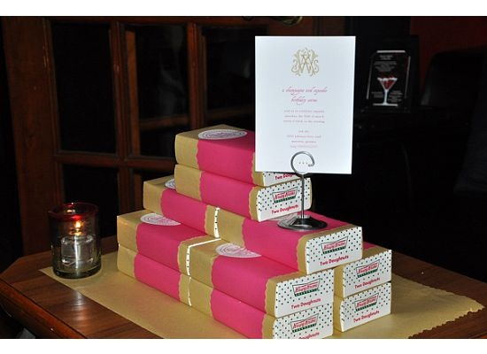 genius. a southern staple: krispy kreme 2-donut boxes wrapped in kraft and pink papers w a custom monogram sticker. Love it!