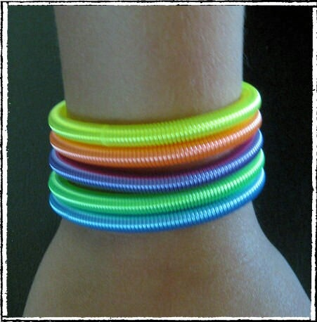 Plastic coil bracelets that pulled the hair out of your arm...