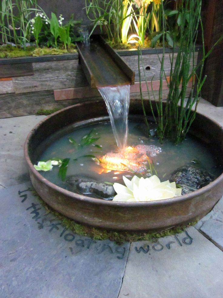Water container garden check the link below for for Simple water features for backyard