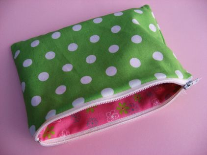 Easy to follow tutorial for sewing a lined zippered pouch. Begin with 2 piece of outer fabric and 2 pieces of lining fabric, all cut the same length as the full length of your zipper and any width you choose.