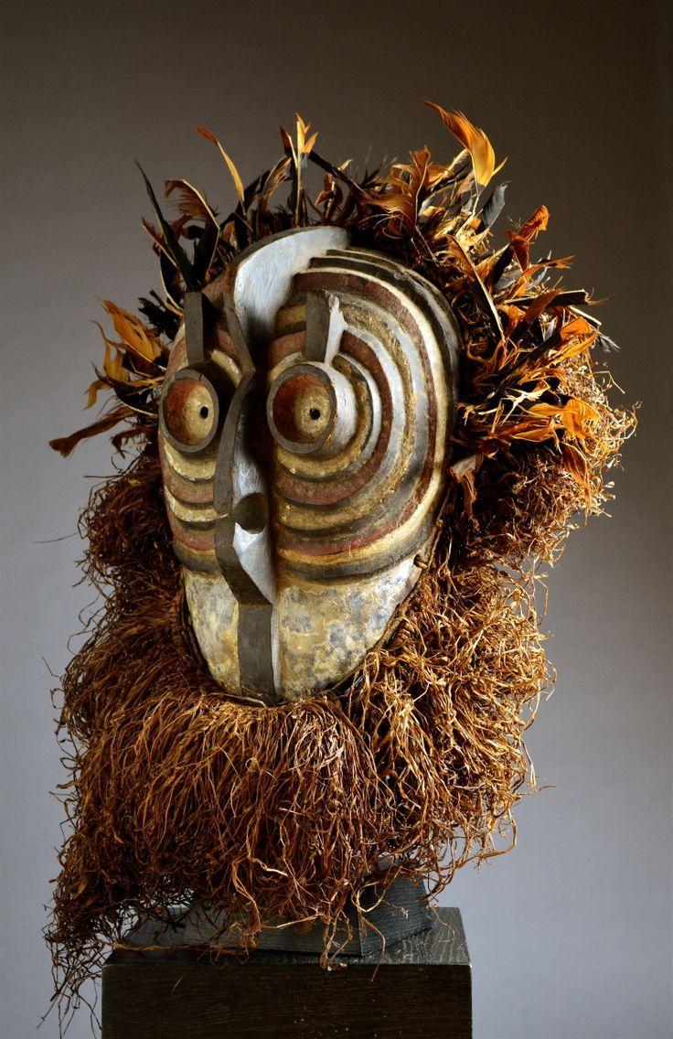 African mask, Luba, Songye country of origin, Congo, mid 20th century. Material: wood, raffia, fibre, shells.