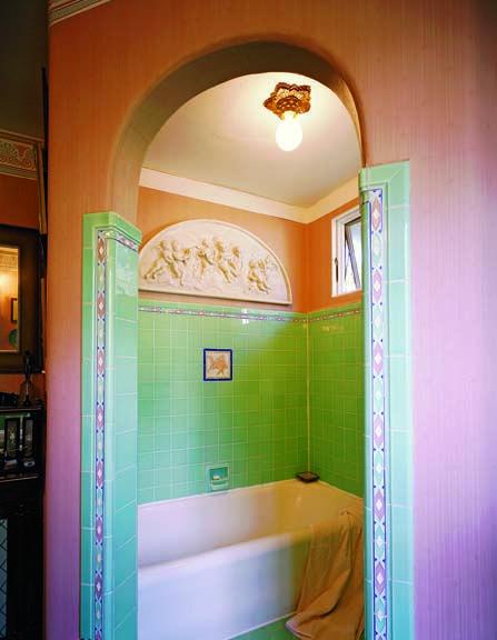 Colorful Art Deco bathtub tile surround.