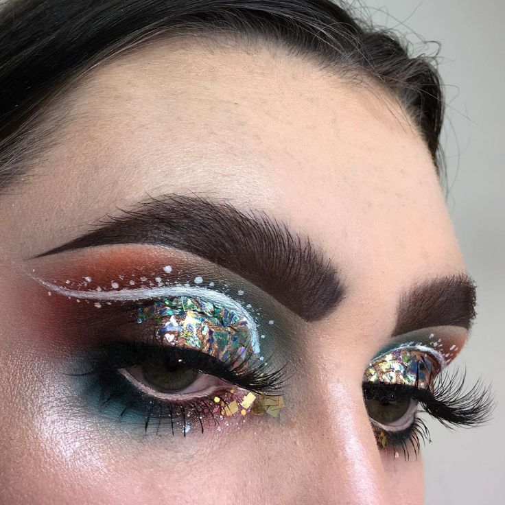 @nyxcosmetics_uk ultimate shadows palette 'brights' @sugarpill pro pans 'flamepoint' & 'kimchi' @anastasiabeverlyhills modern Renaissance palette 'primavera' 'realgar' & 'Cyprus umber' & Subculture palette 'axis' & 'fudge' Glitters are both chunky glitters from @sparkle_season in 'blue buttercream' & 'cinnamon roll' @mehronmakeup liquid makeup in white