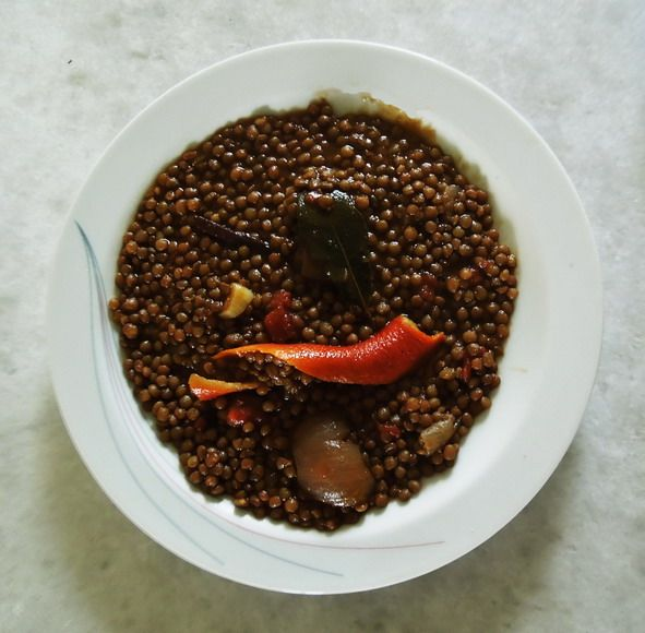 Eat lentils as the Cretans do . (With onions. garlic, tomato paste, fresh tomato, orange peel, laurel leaf, cinnamon stick, olive oil)