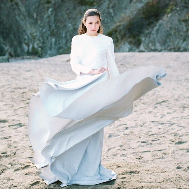 Love the movement of our satin Valeria Skirt in this photo by @ashleypaigephoto.  Available now at most of our bridal stockists.  Silk tunic from @therow #erichmcveyworkshop #alexandragreccobridal #oncewed
