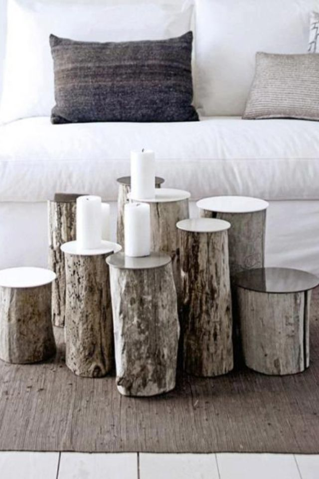 Glass or metal topped treetrunks grouped to for a coffee table