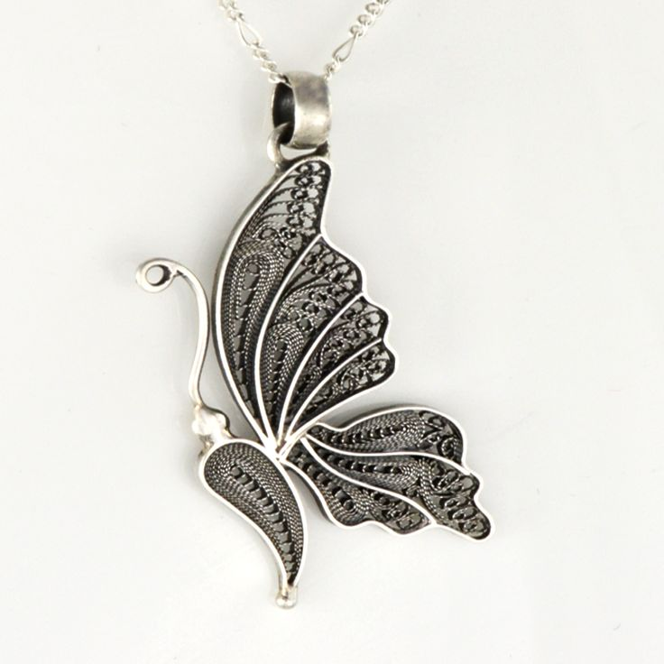 Beautiful silver filigree used in this butterfly pendant.
