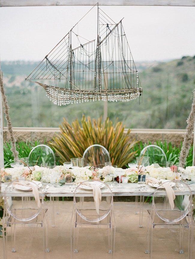 Love the ship chandelier that hung above the head table from this Shipwrecked Winter Beach Wedding
