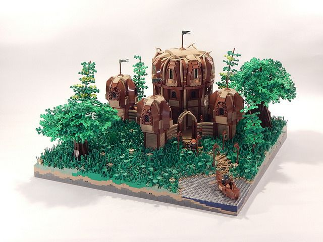 The Elven Fortress of Valahadrian is located deep in the Mystic Isles of Avalonia, and was created from the imagination of LEGO builder Tirrell Brown. The  tan and reddish brown colour combination fits well into the green woodland landscape surrounding the fortress. I love the unusual circular construction with overgrown arches to give a really …