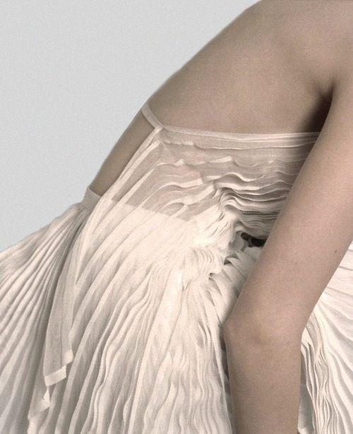 'Issey Miyake' creating wearable art...tiny knife pleating...extraordinary fem chic!