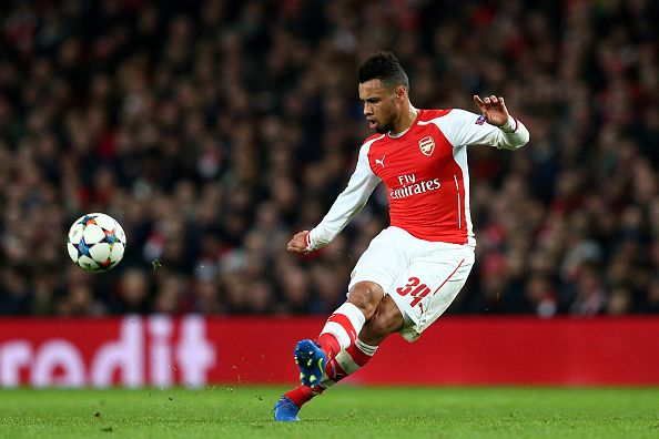 Francis Coquelin of Arsenal passes the ball during the UEFA Champions League round of 16, first leg match between Arsenal and Monaco at The Emirates Stadium on February 25, 2015 in London, United Kingdom