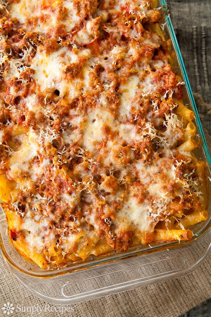 Baked Ziti! Classic Italian American comfort food. Pasta baked with sausage, tomato sauce and all kinds of gooey, yummy cheeses. So EASY, perfect for a family meal!! On SimplyRecipes.com