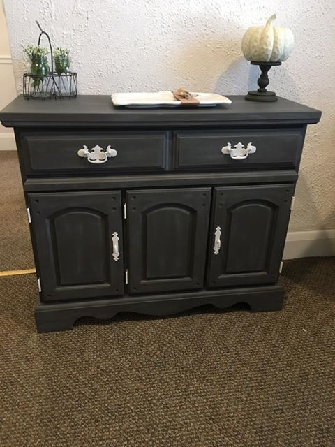 Carlyn Smith Creations created this small buffet, liquor cabinet, bar, etc. with Dixie Belle Paint Gravel Road with Best Dang Wax in White.